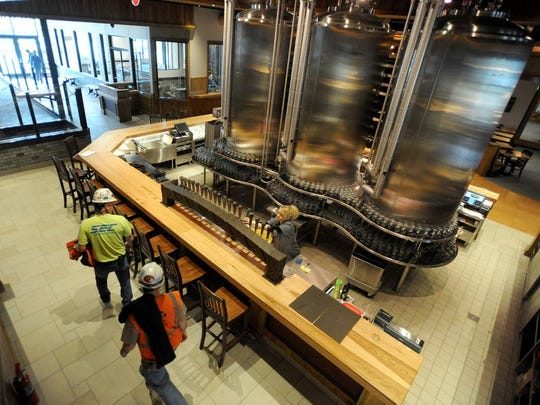 Construction workers and employees of Sierra Nevada prepare for the official opening of its taproom and restaurant at the Mills River brewing facility in 2015.
