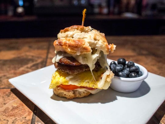 Cafe 64's epic biscuit sandwich features sausage, egg, cheese, tomatoes and aioli on a homemade biscuit.