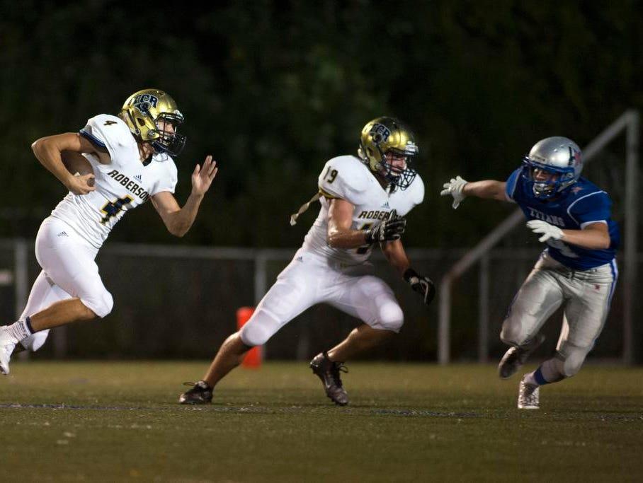 Robertson's Robert Balcom, left, intercepts a pass from McDowell quarterback Casey Ray in the first quarter Friday against McDowell at Robertson High School.