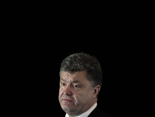 Ukrainian President Petro Poroshenko delivers an address