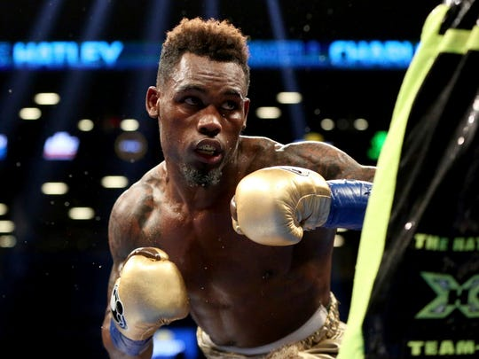 Jermell Charlo, left, in action against Charles Hatley during their fight Saturday.