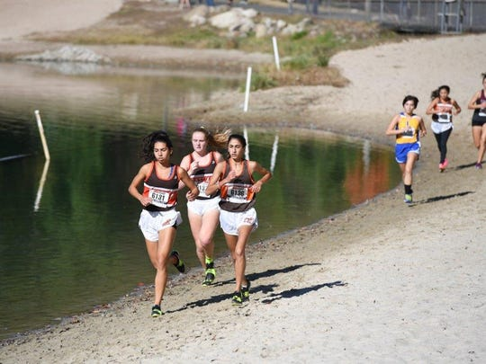 Hannah Figueroa, left, Emily Prendergast, center, and Sylvie Najarian of Pascack Hills running 6-7-8 midway through the Girls C race at the Bergen County Cross-Country Championships. They ended up 9th, 7th and 6th respectively to lead the Cowgirls to first their Bergen group title since 1991.