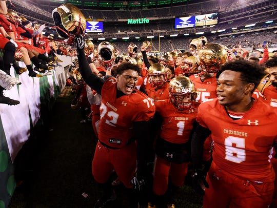 Bergen Catholic players celebrating after winning their