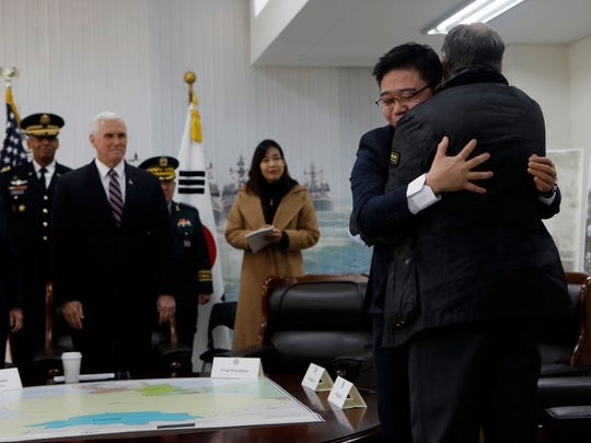 Fred Warmbier (R), the father of Otto Warmbier who was imprisoned in North Korea for 17 months gives hug to Ji Seong-ho (second left), North Korean defector while U.S. Vice President Mike Pence looks on at the meeting room in the South Korean Navy 2nd Fleet Commnad on February 9, 2018 in Pyeongtaek, South Korea. The U.S. Vice President Mike Pence is visiting South Korea and will lead the U.S. delegation in the opening ceremony of PyeongChang Winter Olympic Games.  (Photo by Woohae Cho/Getty Images)