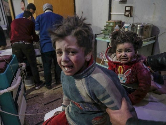 Injured children are treated at a hospital in rebel-held