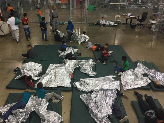 Handout photo made available June 18, 2018, on 18 June 2018 by the US Customs and Border Patrol showing people inside a United States Border Patrol Processing Center, in McAllen, Texas, USA.