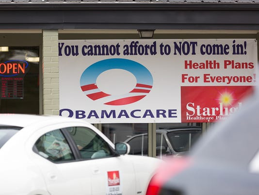 texas-tribune-obamacare-sign.jpg