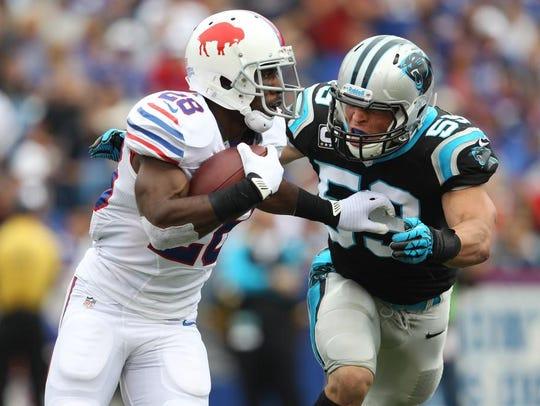 Bills RB C.J. Spiller (28) tries to escape Cariolina