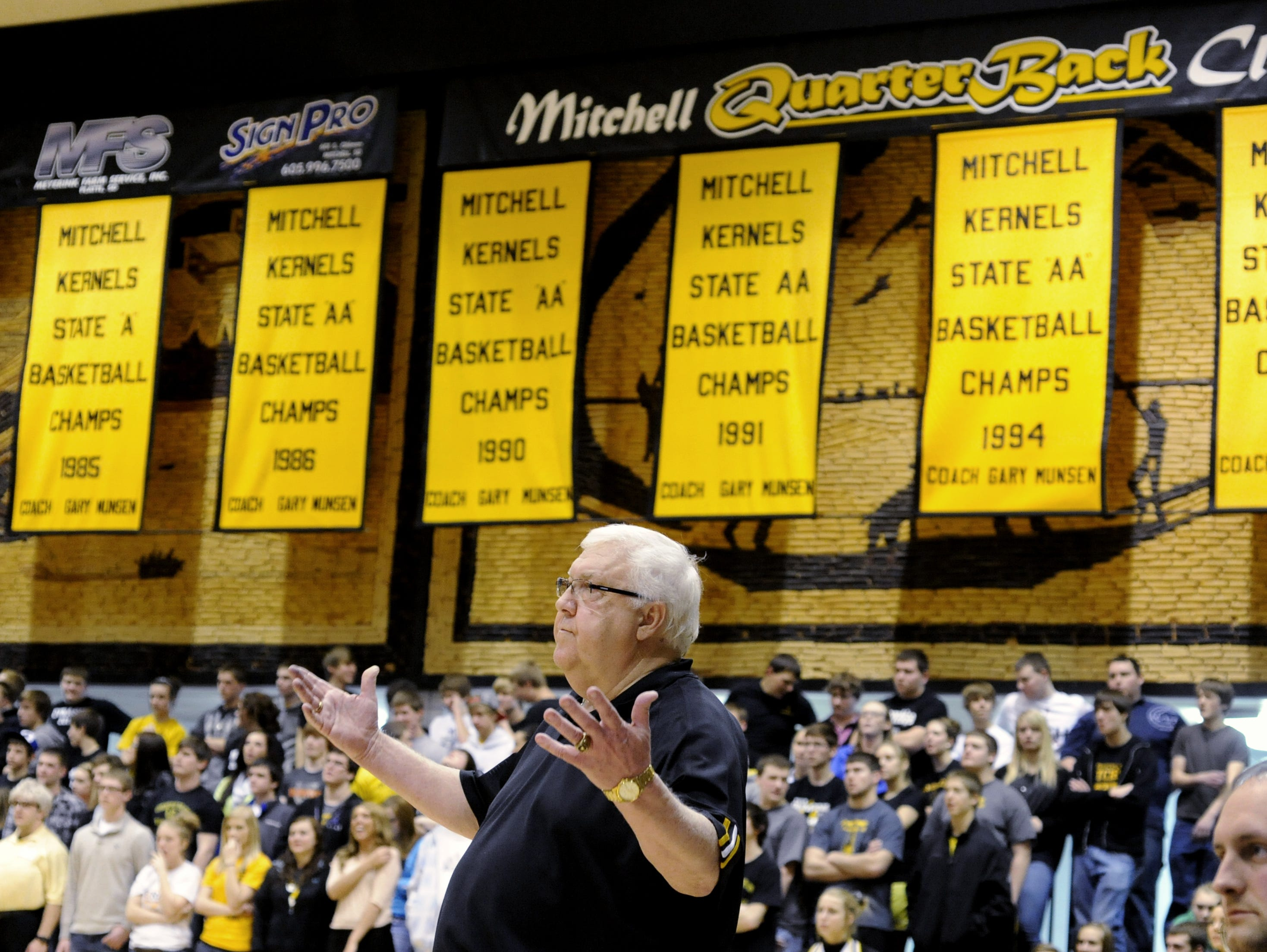 Gary Munsen works the sideline at the Corn Palace in Mitchell on Feb. 14, 2012. Banners draped behind him signify some of the state titles the Kernels won under his watch. Munsen died Jan. 12, 2016.
