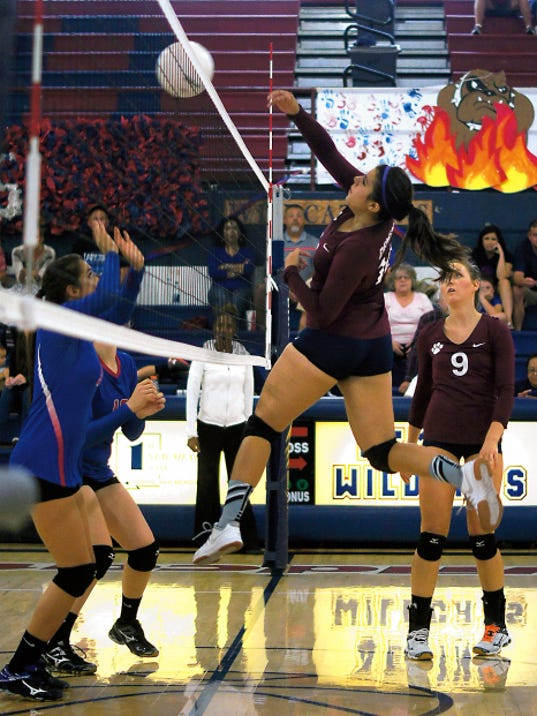 Bill Armendariz — Headlight Photo   Senior middle blocker Liz Perez has elevated her game during the Lady Wildcats recent  three-match winstreak. Perez collected four kills and a block from the middle of the net.