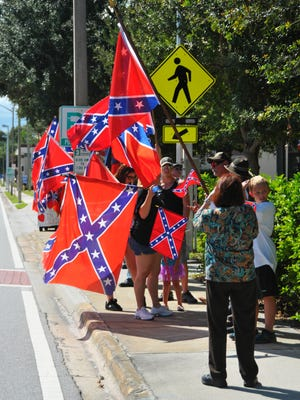 FILE- Dozens of Confederate flag opponents and supporters were outside Melbourne City Hall on September 25.