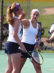 Kylie Moellering, left, and Sarah Frisch, of Notre Dame rally together between points. Ninth Region girls tennis semifinals.