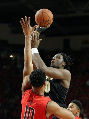 Purdue forward Caleb Swanigan attempts a shot defended by Maryland's LG Gill (10) this past Saturday.