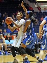 MTSU forward Cheyenne Parker (blue) scored 25 points and grabbed 10 rebounds against Ole Miss Sunday in Oxford, Miss.