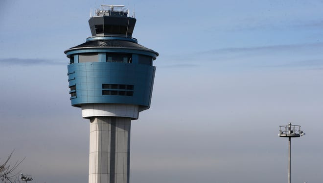 File photo: An air traffic control tower rises above a ramp serving LaGuardia Airport in New York on Jan. 21, 2015.