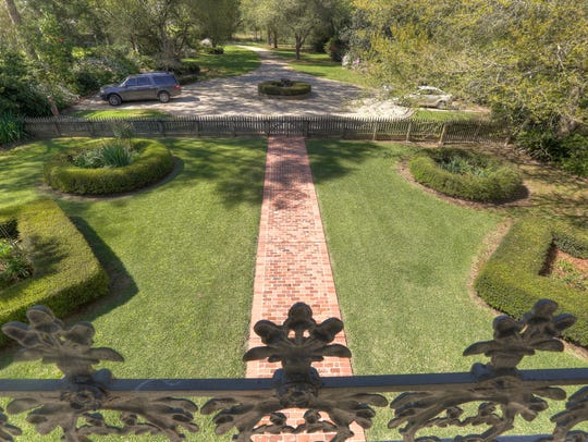 Arlington sits on almost 3 acres of gorgeous landscaped