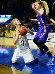 Riverside's Holly Chumney attempts to shoot from the