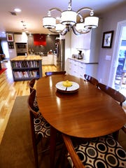 Eat at a large dining table in the home of Wanda and Darnell Thompson, or dine at the large island behind it.