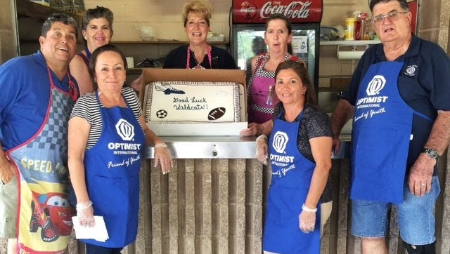 The Deming Optimist Club kept with tradition by serving Deming High fall athletes grilled hamburgers with all the trimmings on Sept. 21, 2016 at the E.J. Hooten Recreational Complex. The club has been providing a cookout for athletes since the early 1970s. Pictured are Optimist Club members, from left, Robert Velez, Kathleen Sayre, Buffy Carbajal, Monika Velez, Karen Sayre, Cleo Santana and club president Tony Sayre.