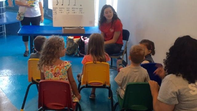 "Children enjoy a music class with The Children's Museum music instructor at ""Kick off to Kindergarten."""