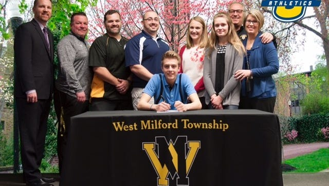 West Milford senior football player and kicker Andrew Finke, center, committed to Wilkes University this past week in front of family, coaches and school administrators. Pictured (L-R): Paul Gorski, Joe Trentacosta, Gary Stoll, Don Dougherty, Suzanne Mentlik, Amanda Finke, John Finke and Leslie Finke.