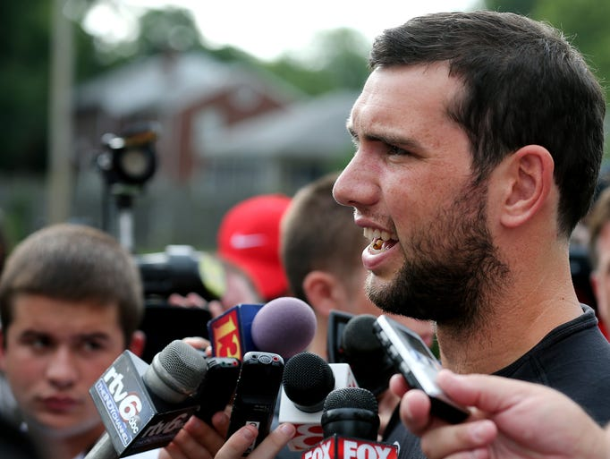 Indianapolis Colts quarterback Andrew Luck talks to media on the first day of training camp, on Wednesday, July 23, 2014, at Anderson University.