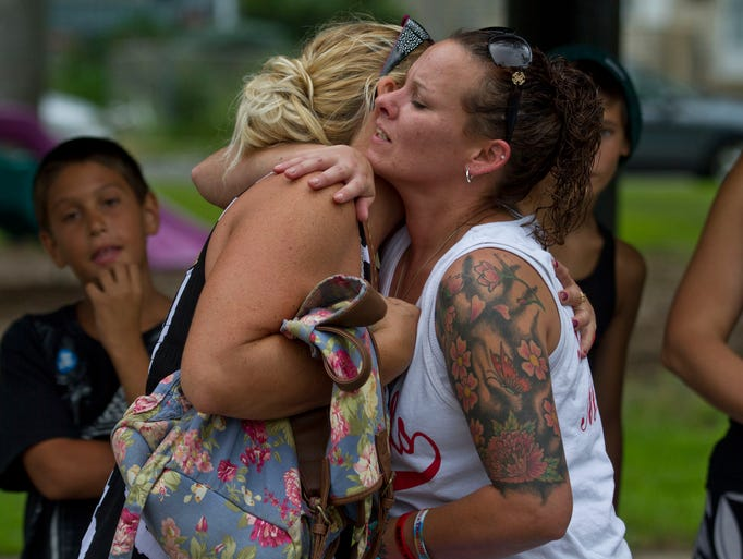 Jackie Cerreta, Drews mother, (right) embraces Dawn Lynch of Keansburg during the remembrance. Family members and friends of Drew Keough, an 11 year old boy who was struck and killed by a car, gather at Forest Park to remember Drew and bring attention to speed limits around parks where children play.  Keansburg, NJ Friday, August 1, 2014 Doug Hood/Staff Photographer