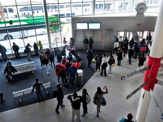 Kids get on buses after school at The Rapid Center in Grand Rapids. The 9.6-mile Silver Line includes a loop downtown.