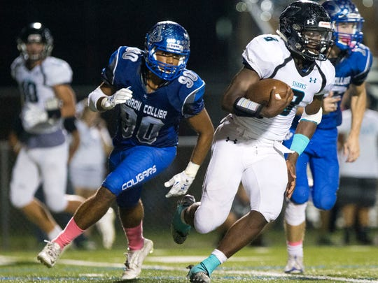 Gulf Coast's Demarcus Townsend (8) carries the ball in the second half of action at Barron Collier High School Friday, October 7, 2016 in Naples. Gulf Coast would win 15-11 clinching their first Catfish Bowl since 2007.