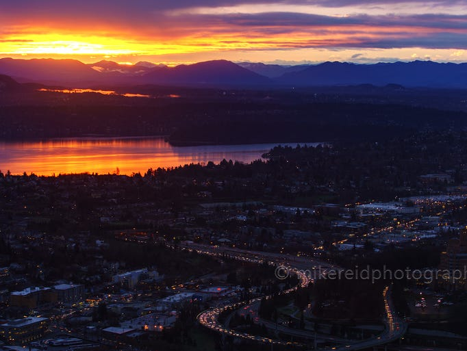 The sunrise creates magical colors over Seattle as