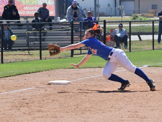 Louisiana College's third baseman Regan LeJeune (12) catches a ball for an out against Howard Payne Saturday.