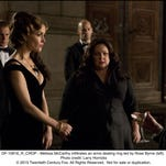 "Melissa McCarthy, center, infiltrates an arms-dealing ring led by Rose Byrne, left, in ""Spy."""