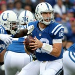 Indianapolis Colts quarterback Andrew Luck (12) fakes the hand off to  running back Frank Gore (23) in the first quarter of their game Sunday, September 13, 2015, afternoon at Ralph Wilson Stadium in Orchard Park NY.