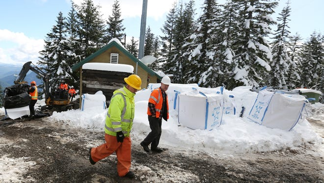 Crews clean up a 450 gallon diesel spill at an AT&T communications tower on Hall Ridge in the Willamette National Forest above Detroit Lake on Monday, Feb. 22, 2016.