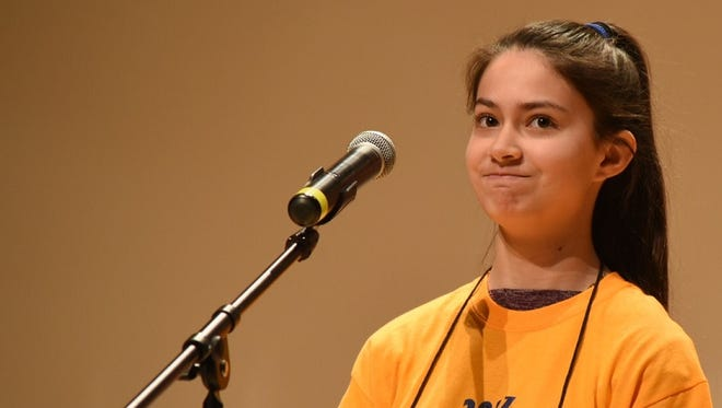 In this March 4, 2017 photo, Erin Welch, an eighth-grade student at St. Francis de Sales Catholic School in Salisbury, spells a word at the fifth annual Maryland Eastern Shore Regional Spelling Bee held at the University of Maryland Eastern Shore. Erin now qualifies for the Scripps National Spelling Bee.