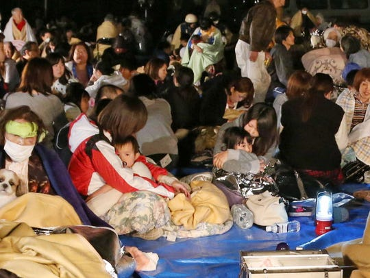 Residents take shelter at the town hall of Mashiki,