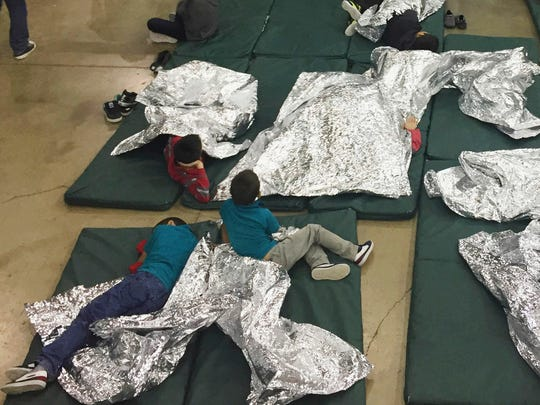 People rest in cages at a detention facility, McAllen, Texas, June 17, 2018. An earlier version of this column included a photograph with an incorrect date.