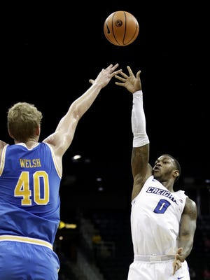 Creighton's Marcus Foster (0) shoots over UCLA's Thomas Welsh (40) during the second half of an NCAA college basketball game in the Hall of Fame Classic, Monday, Nov. 20, 2017, in Kansas City, Mo. Creighton won 100-89.
