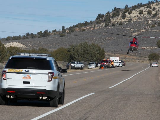 A Life Flight helicopter lands on the highway in preparation for transporting the driver of a late-model Isuzu pickup truck after a deer leapt over an SUV and landed on the hood and roof of th man's pickup while it and the SUV were both traveling at about 65 miles per hour on the state highway near Diamond Valley Wednesday, Dec. 2, 2015.