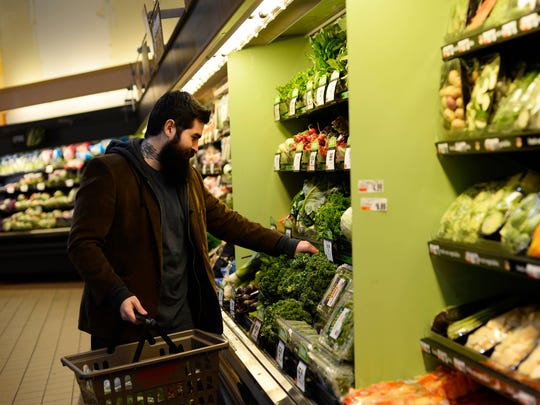 Nicolas Humeny of York picks out greens at Giant in West Manchester Township.