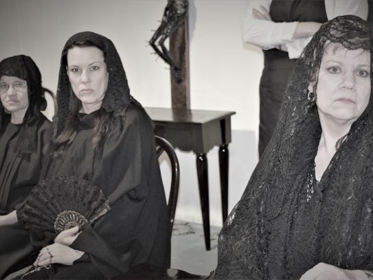 Bernarda (Anne Gorski) sits with her daughters in mourning