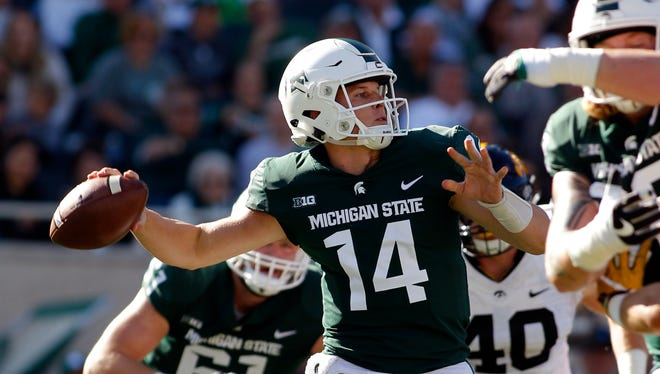 Michigan State quarterback Brian Lewerke throws a pass against Iowa in the first quarter Saturday, Sept. 30, 2017 in East Lansing.