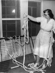 A nurse at the Arizona State Hospital holds an escape rope made from rags and other materials which Judd used to escape with in 1952. Republic Photo