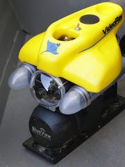 An ROV — remotely operated vehicle —functions as a