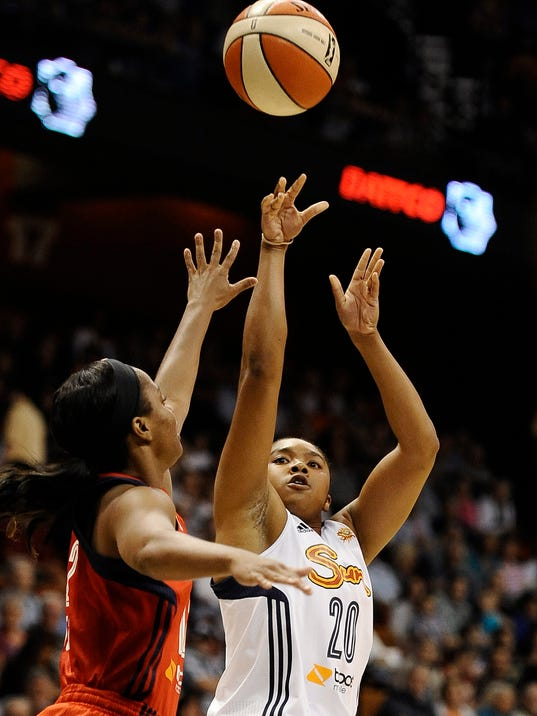 Connecticut Sun's Alex Bentley, right, shoots over Washington Mystics' Ivory Latta, left, during the first half of a WNBA basketball game, Sunday, Aug. 10, 2014, in Uncasville, Conn. The Sun won in double overtime 89-81. (AP Photo/Jessica Hill)