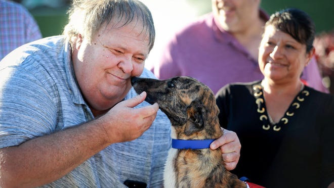 Jerry Koppe of Koppe, Staats & Collins Kennel gets a kiss from Pat C Dewdrop after winning the 40th and final running $50,000 He's My Man Classic at Palm Beach Kennel Club Saturday, January 25, 2020 in West Palm Beach.