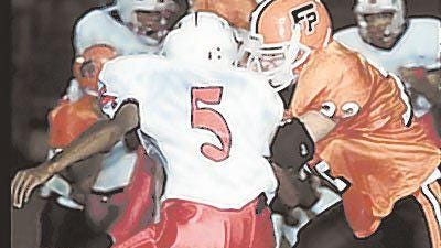 Freeport's Adam Schlamp (right) makes a tackle his junior season, when he was named NIC-10 (then NIC-9) Defensive Player of the Year in 2002. Schlamp was also a three-year starter on offense and special teams for a Pretzels team that won three consecutive undefeated conference titles.