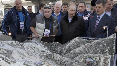 In this Wednesday, Feb. 6, 2013 file photo Russian President Vladimir Putin, second right, visits the Rosa Khutor Alpine Center in Rosa Khutor outside the Black Sea resort of Sochi, southern Russia. RussiaÂ?s most powerful have reason to be worried about the economic fallout from the takeover of Crimea and the sanctions imposed by the West as forecasts for RussiaÂ?s economy have dropped sharply and capital flight is soaring. From left, Head of the Sochi 2014 Organizing Committee Dmitry Chernyshenko, Interros Investment Company President Vladimir Potanin.