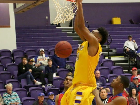 Jyrus Freels dunks during a game this season. He started 20 of 31 games, averaging 11.2 points and 6.7 rebounds.