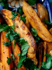 Sweet potato wedges are served with lime mayo.